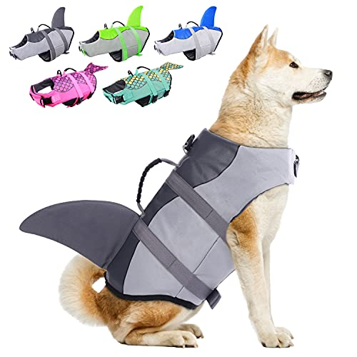 dog wearing gray shark fin life jacket and harness with other color options in background
